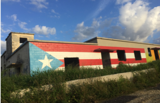 The Puerto Rican flag is seen painted on a building