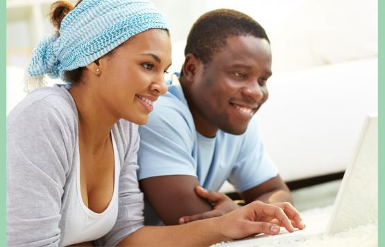 Black couple with laptop