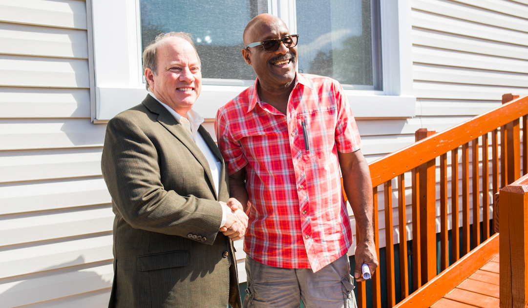 Mayor Mike Duggan (left) stands with Jose Guzman (right)