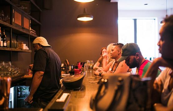 A group of people sit at Brix wine bar